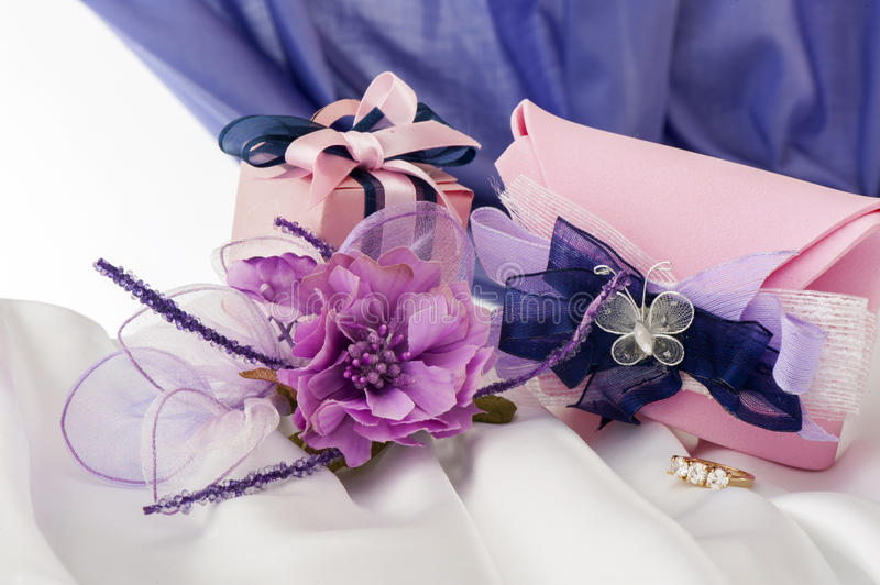 Wedding rings on colorful fabric. Wedding favors on a colorful fabric background royalty free stock photo