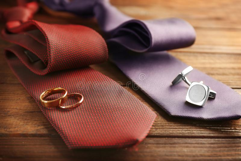 Wedding rings and cuff-links on ties. Closeup royalty free stock images