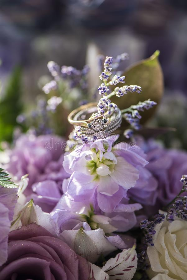 Wedding rings on floral stock images
