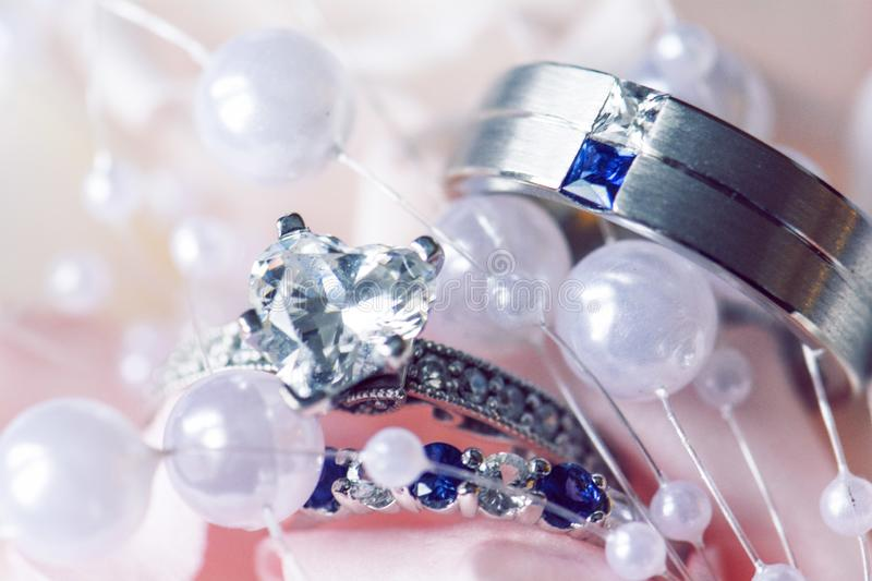 Wedding rings on floral stock photography