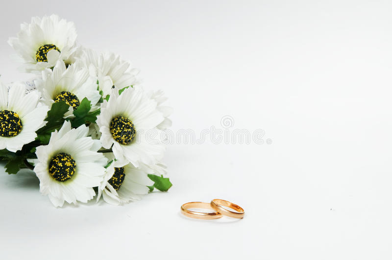 Wedding Rings And Flowers Royalty Free Stock Photography Image