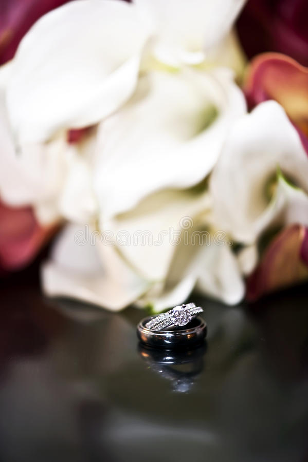 Download Wedding rings and Flowers stock image. Image of diamond - 17690163