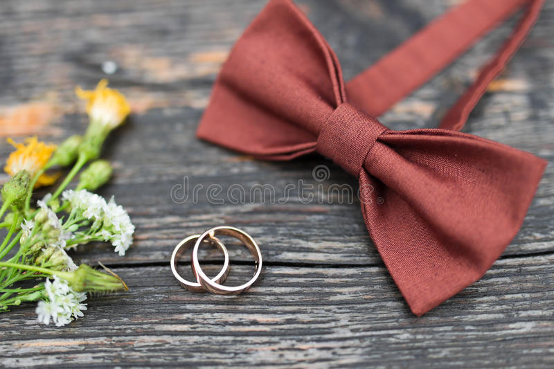 Wedding rings on the groom tie stock photos