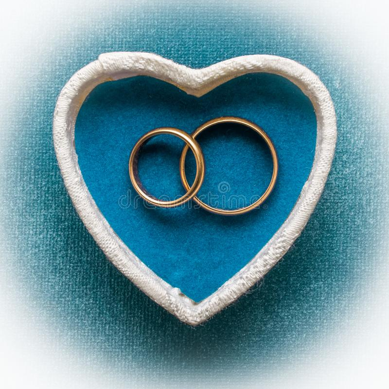 Wedding rings in heart shaped white box royalty free stock photography