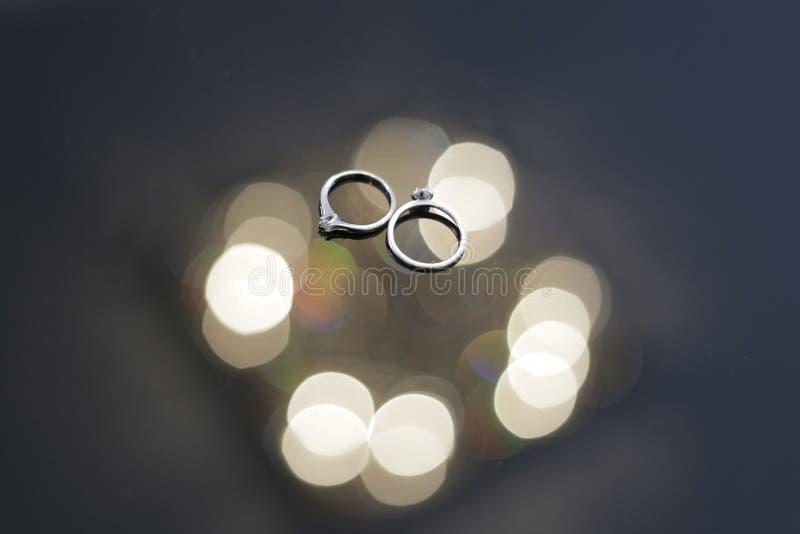 Wedding rings among highlights. Wedding accessories, wedding rings among highlights, Bokeh stock photography