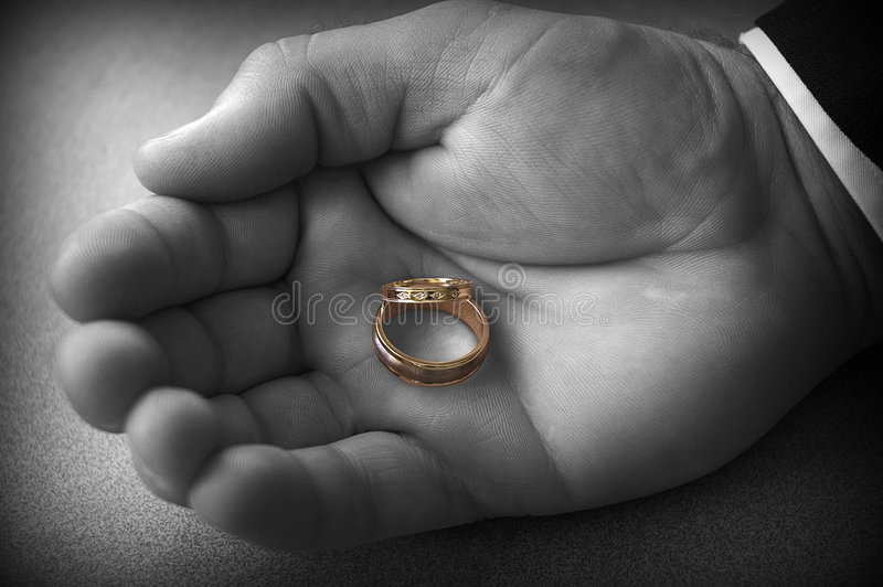 Wedding Rings I. A pair of new wedding rings held in the Best Man's hand royalty free stock images