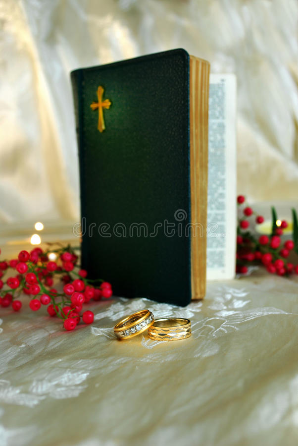 Wedding Bands and a Bible royalty free stock image