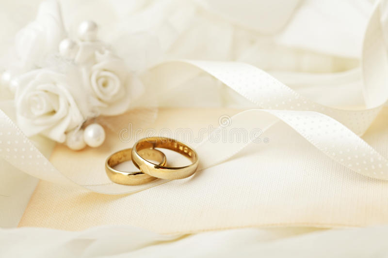 Wedding rings. And invitation card stock photo