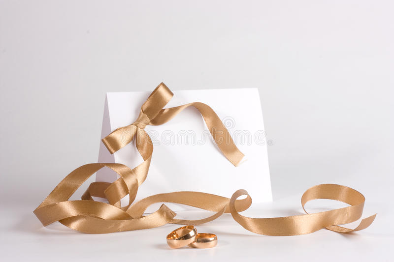 Wedding rings and invite royalty free stock photography