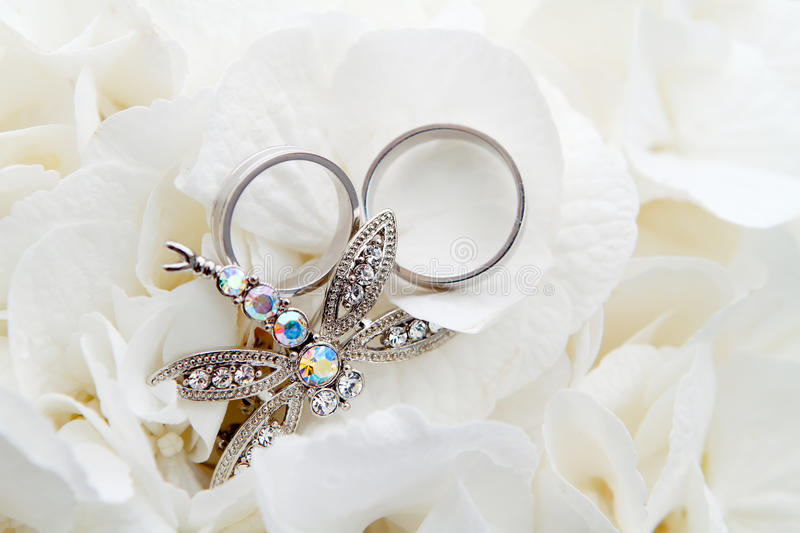 Wedding Rings with jewel. Wedding Rings detail with jewel and flowers royalty free stock photo
