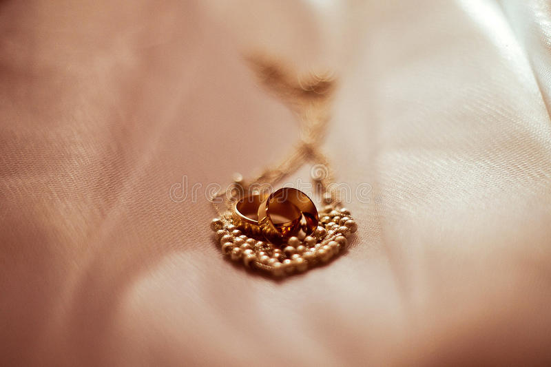 Wedding rings and jewelery royalty free stock photography