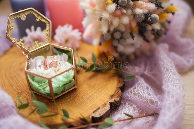 Wedding rings in jewelry box, romantic vintage style.  royalty free stock image