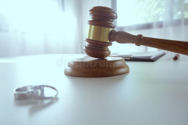 Wedding rings and Judge gavel hammer on Lawyer desk royalty free stock photos