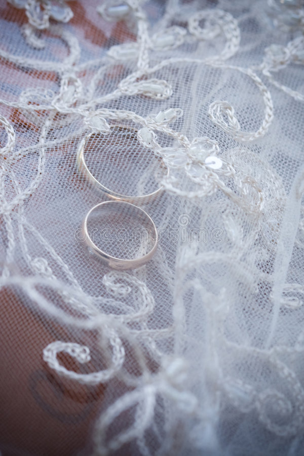 Wedding rings and lace stock photo