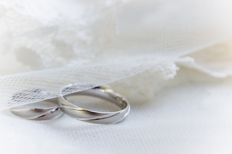 Wedding rings on a lace background royalty free stock photography
