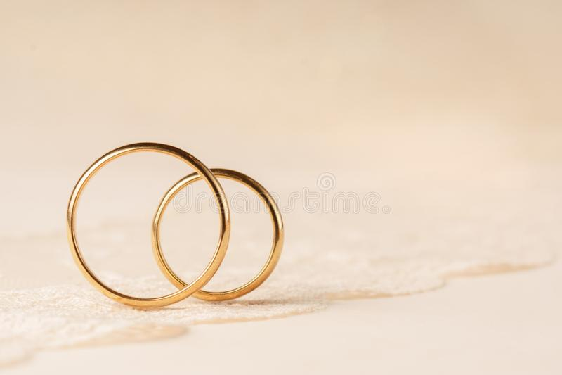 Wedding rings on lace. stock photos