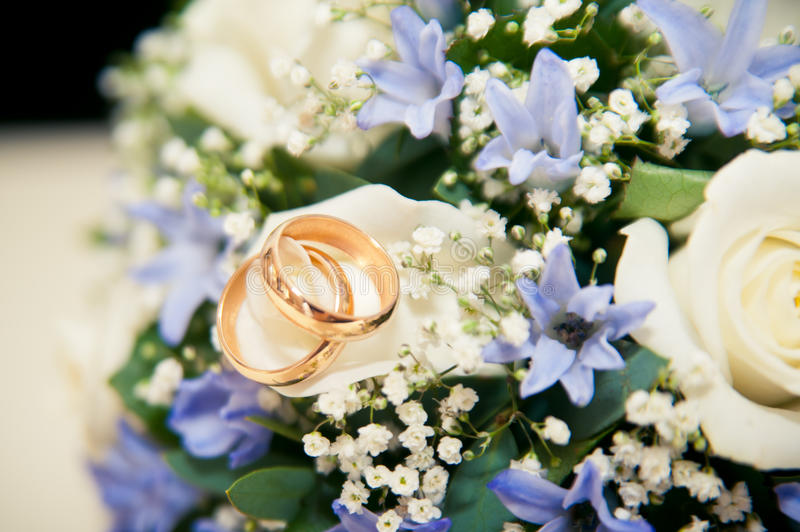 Wedding rings lie on a bouquet royalty free stock image