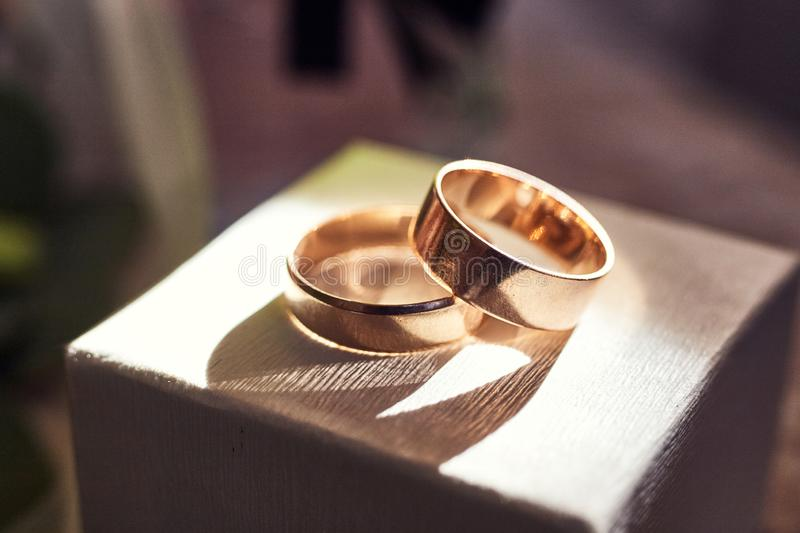 Wedding rings lie on the box near a wedding bouquet royalty free stock image