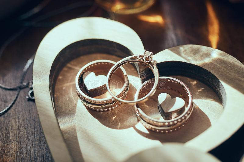 Wedding rings lie on the box near a wedding bouquet royalty free stock photography