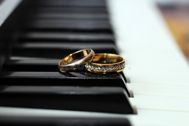 Wedding rings, love and happy, music stock photo