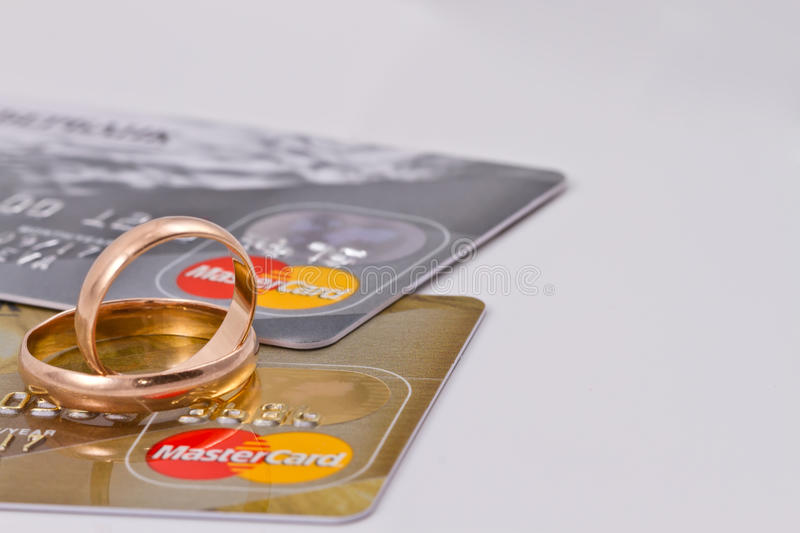Wedding rings and mastercard gold royalty free stock photography