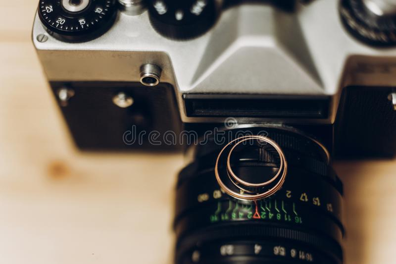 Wedding rings on old photocamera. wedding photographer concept,. Space for text stock photos