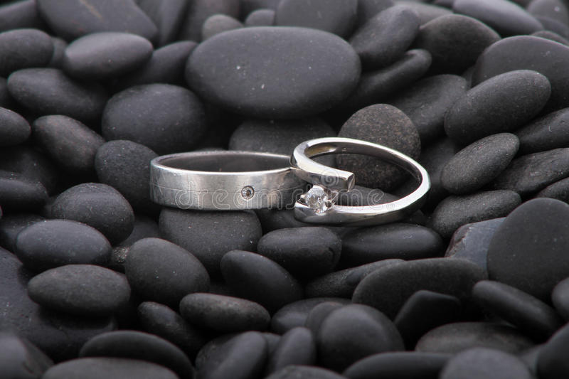 Download Wedding rings on pebbles stock photo. Image of pebbles - 26229458
