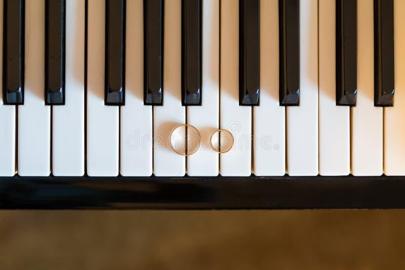 Download Wedding rings on piano stock image. Image of black, macro - 40982025