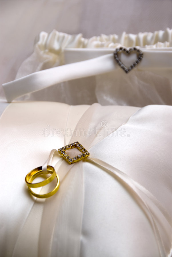 Wedding Rings And Pillow Stock Images