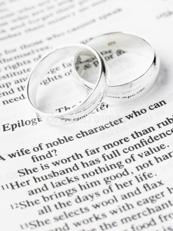 Wedding Rings Resting On A Bible Stock Photo Image Of