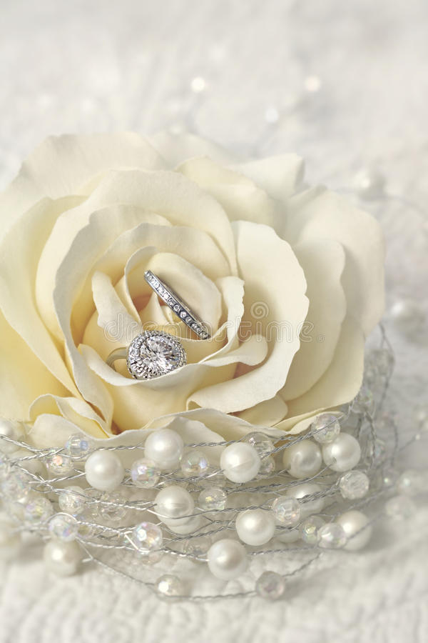 Wedding rings in rose flower royalty free stock photos