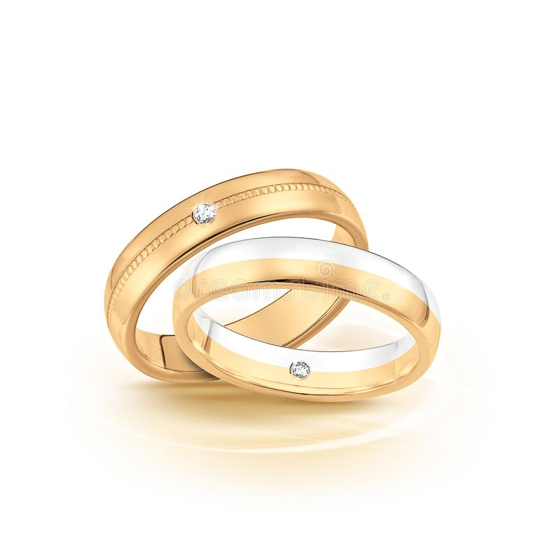 Wedding rings set of gold and silver metal on white background. Beautiful handmade jewelry. Wedding rings set of gold and silver metal on white background stock photo