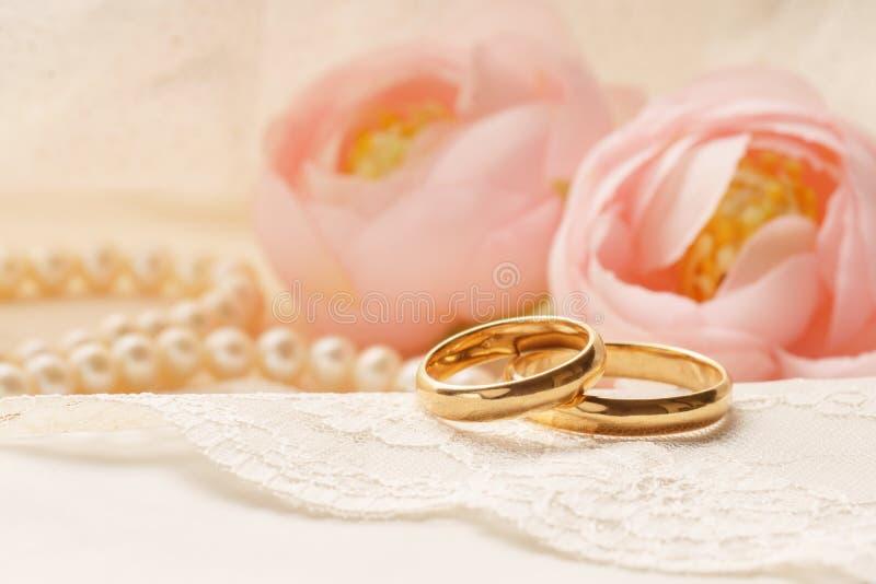 Wedding rings on silk. stock photo