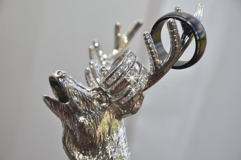 Wedding rings on silver elk antlers royalty free stock images