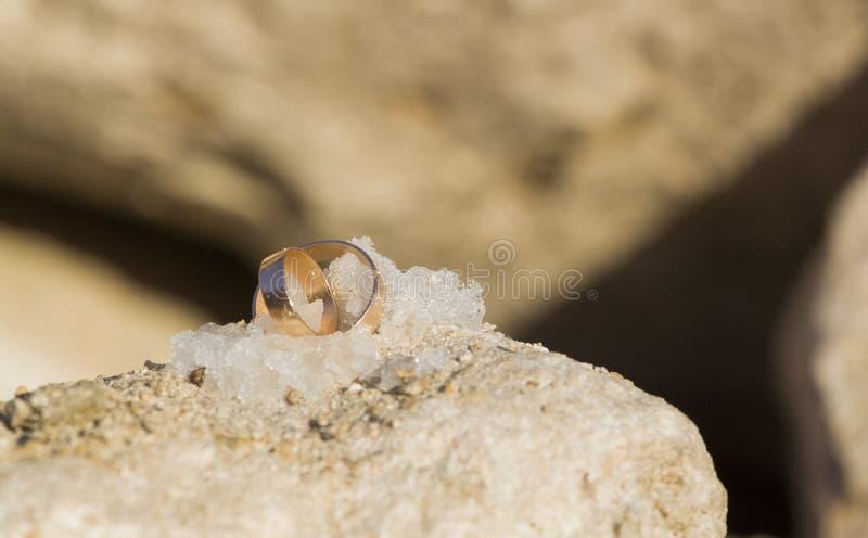 Wedding rings in snow stock photos