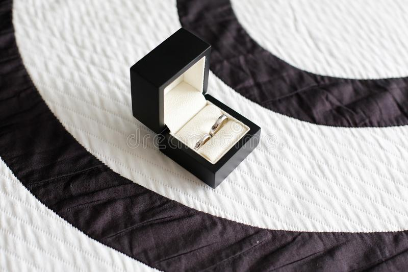 Wedding rings in a special little box stock images