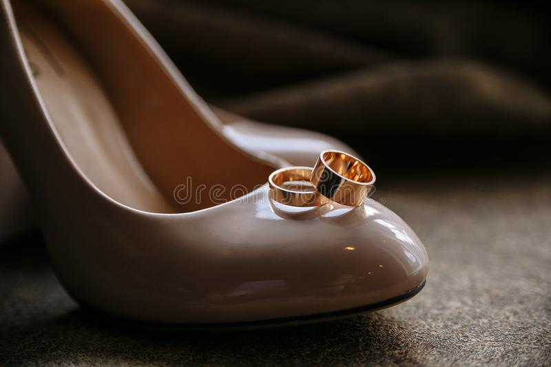Wedding rings on the tip of brown shoes. close up.  royalty free stock photography
