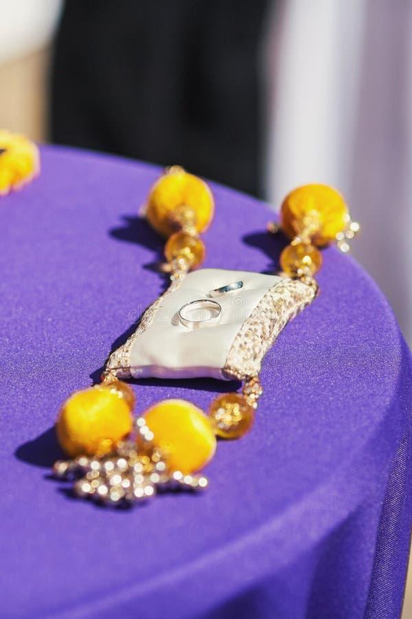 Wedding rings. Two wedding rings on cushion royalty free stock image