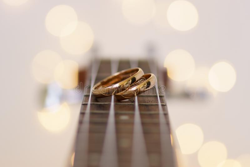 Wedding rings on ukulele guitar strings royalty free stock photos