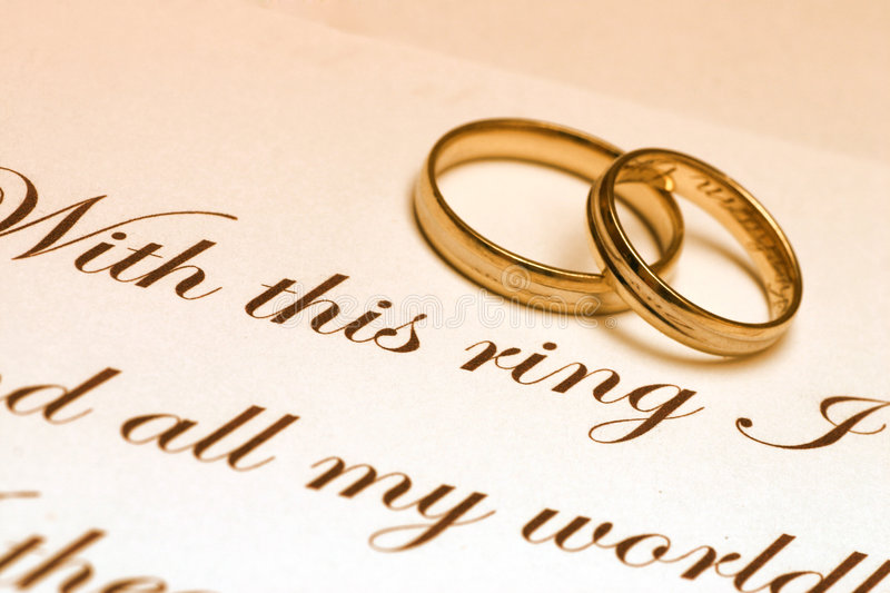 Wedding Rings And Vow. Two wedding ring laying on a paper with text of wedding vow. I will be very happy if you let me know when you use this image in your royalty free stock photography