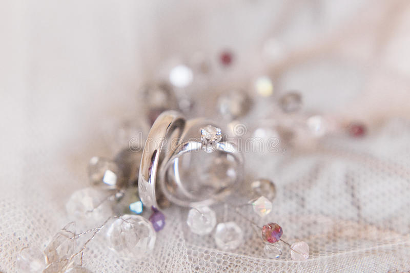 Wedding rings of white gold and angage ring royalty free stock photo