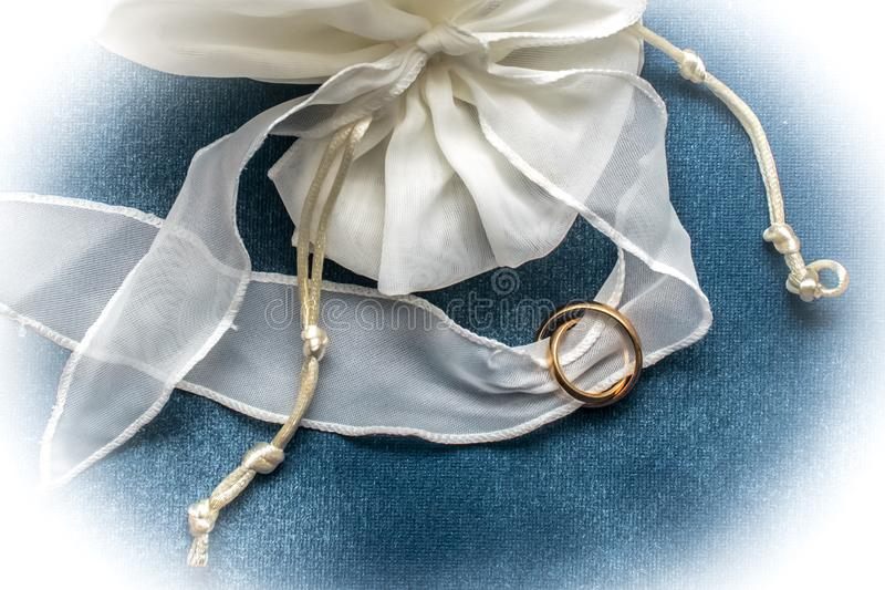 Wedding rings with white ribbon stock photo