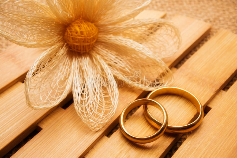 Wedding rings on wooden background royalty free stock photography