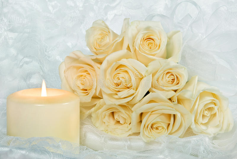 rose bouquet and candle on lace stock photography