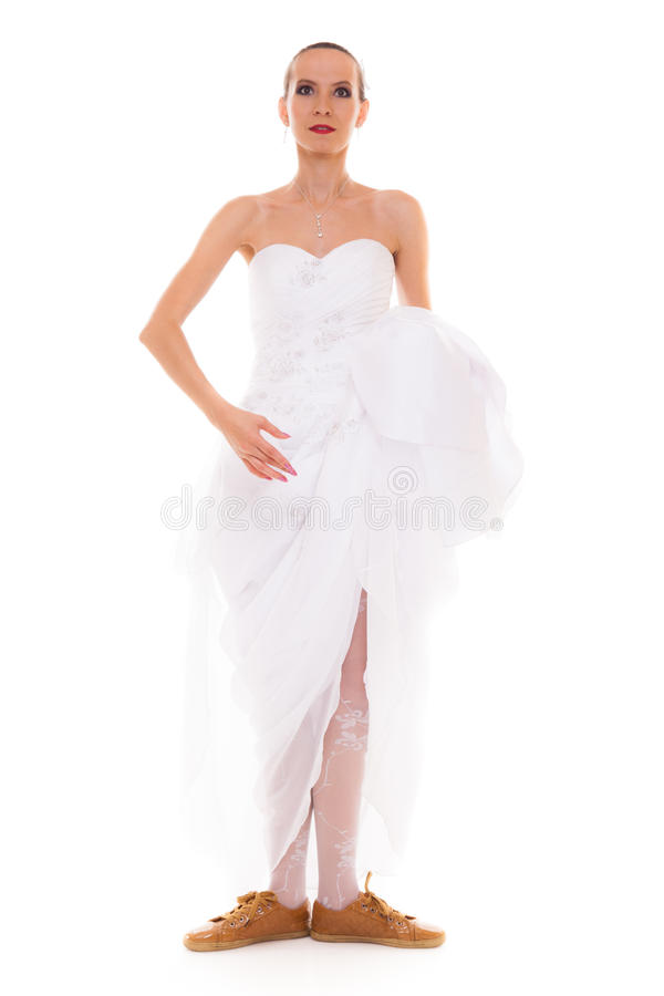 Wedding. Running bride funny woman in sport shoes stock photography