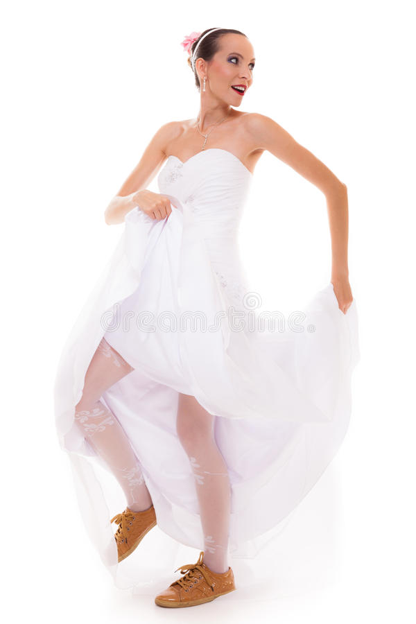 Wedding. Running bride funny woman in sport shoes royalty free stock images