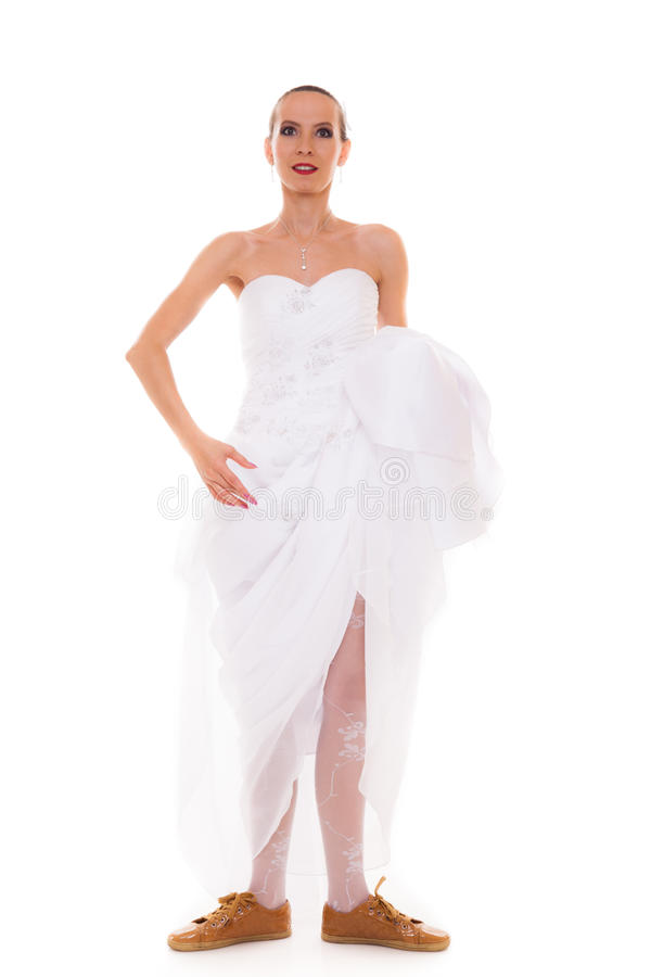 Wedding. Running bride funny woman in sport shoes royalty free stock photos
