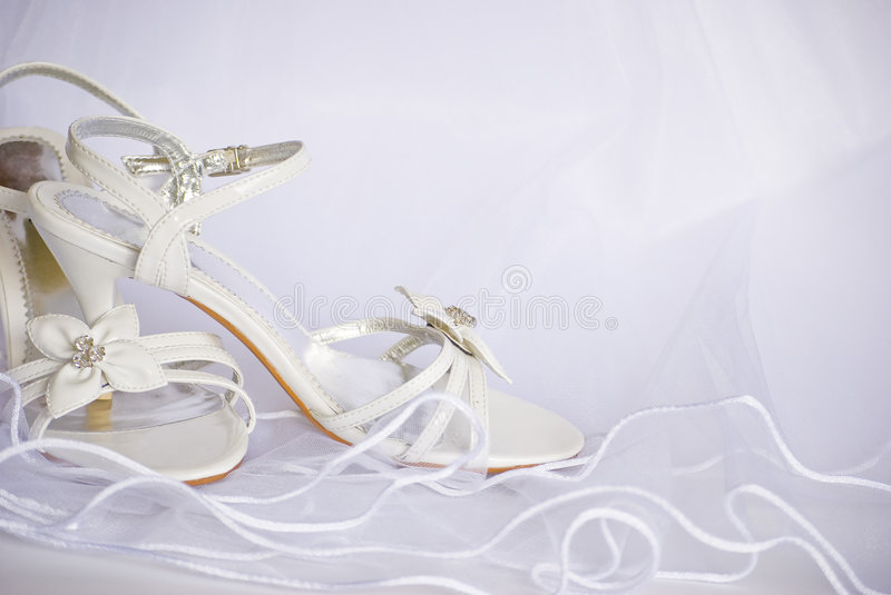 Wedding Sandals And Flowers Over Veil Stock Photography
