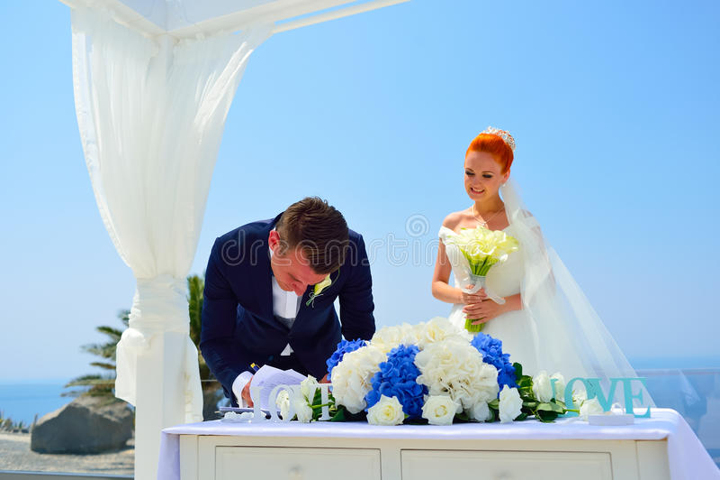 Wedding on Santorini. Beautiful young couple bride and groom celebrate wedding on Santorini royalty free stock photography