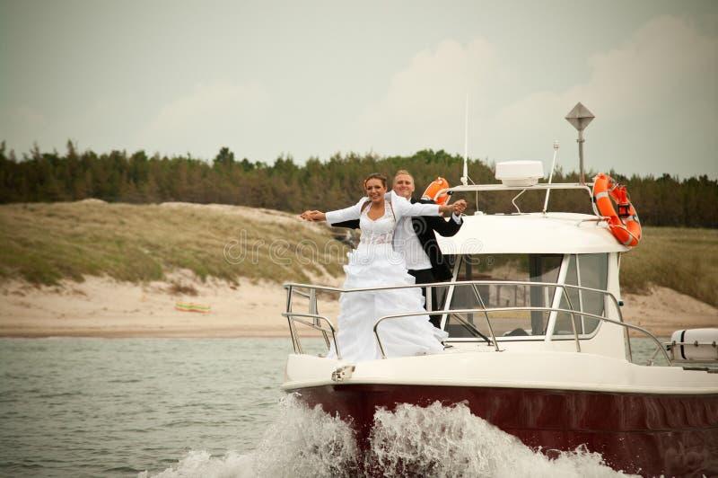 Wedding scene on motorboat stock photos